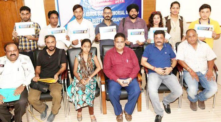 Winners of Ashok Sodhi Memorial Awards displaying their certificates.  Excelsior/Rakesh