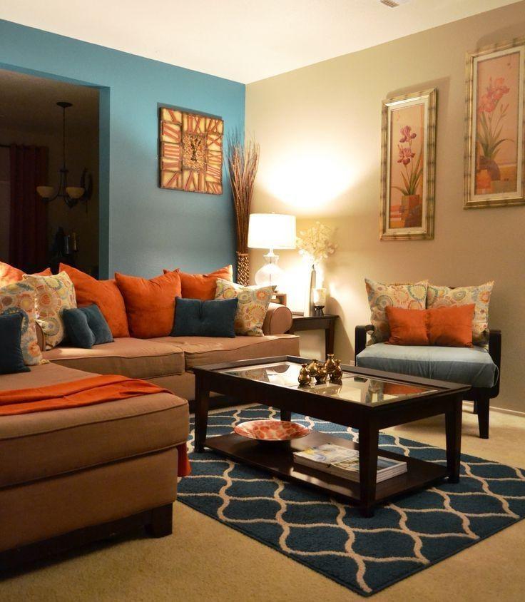 Teal Decor Brown And Orange Living Room Teal Living Room Ideas Orange Home Decorations Mavi Oturma Odasi Oturma Odasi Tasarimlari Yemek Odasi Takimlari