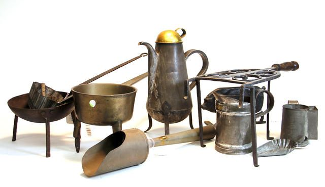 Thirteen tin and iron scoops molds, iron pots, trivets, coffee pot, door stop and rattles 19th century