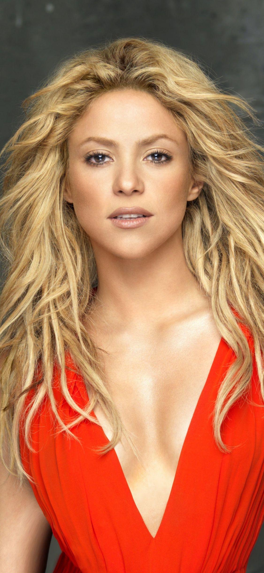 Shakira Blonde Singer Red Dress 1125x2436 Wallpaper