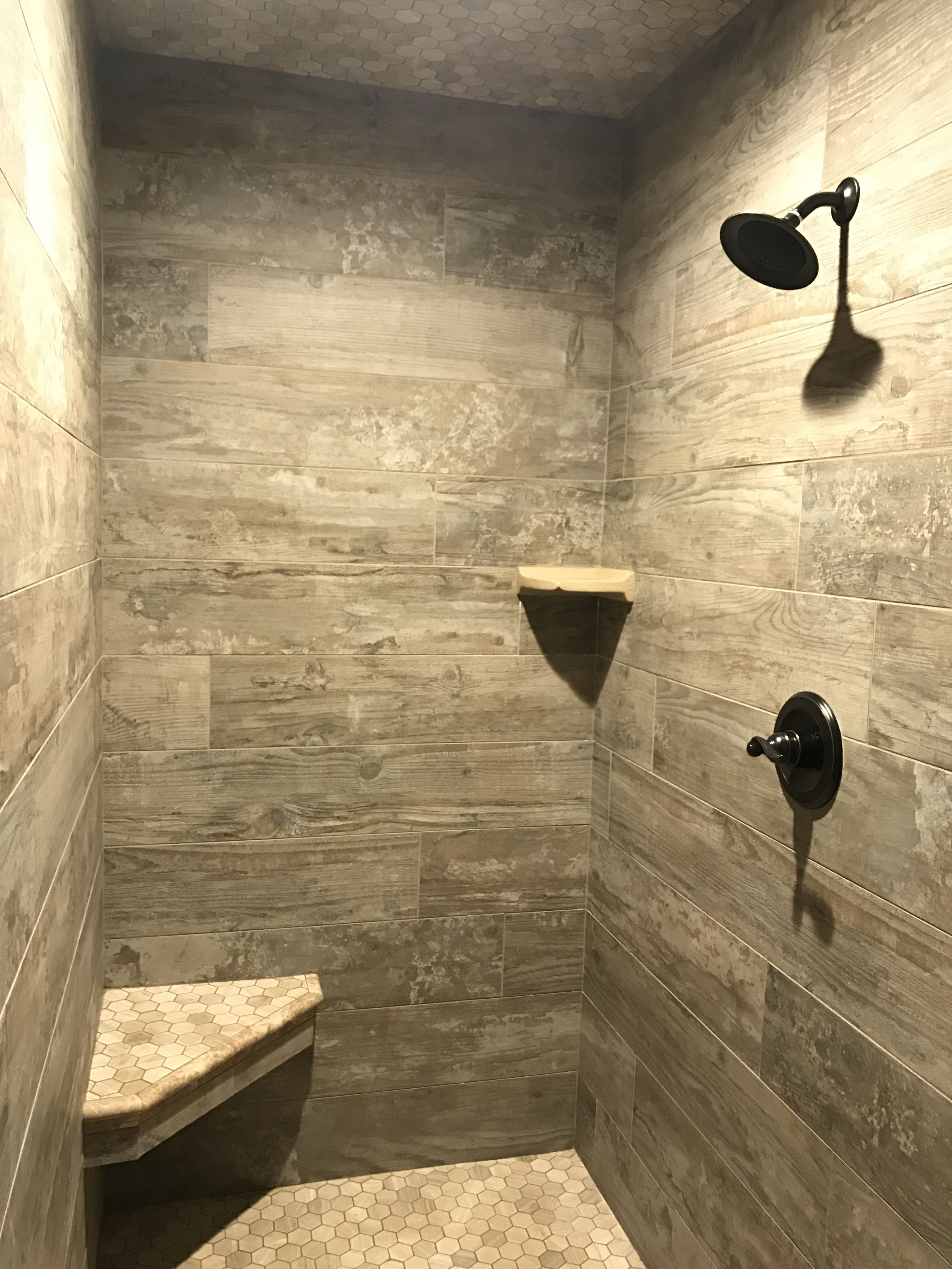Our master shower is a Wood tile walk in shower with grey hexagon ...