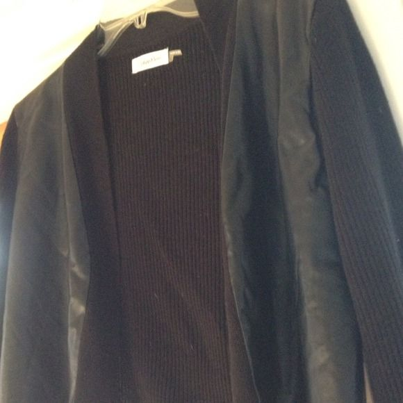 Calvin Klein ribbed cardigan with vinyl front Short-waisted, ribbed cardigan. Made by Calvin Klein. Lightweight sweater that hits right at the waist. Front panels covered in vinyl. Black, size large. Calvin Klein Sweaters Cardigans