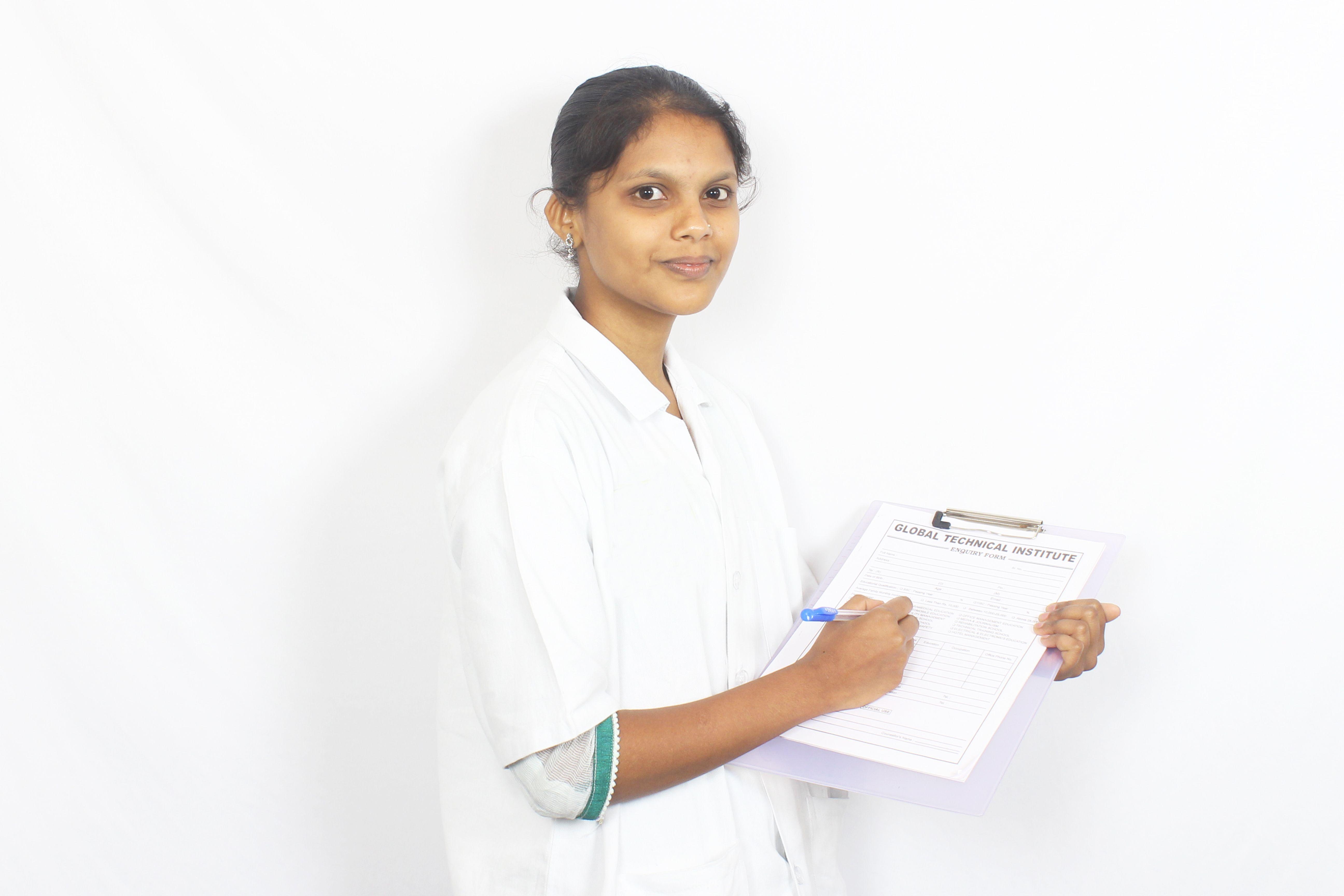Indian Nurse updating patients records. | Nursing Students ...