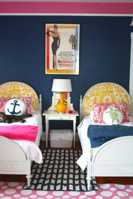 cute cute girls bedroom--two twin beds, navy, hot pink, yellow color scheme. Love the breakfast at tiffany's movie poster. adds some audrey hepburn class to it