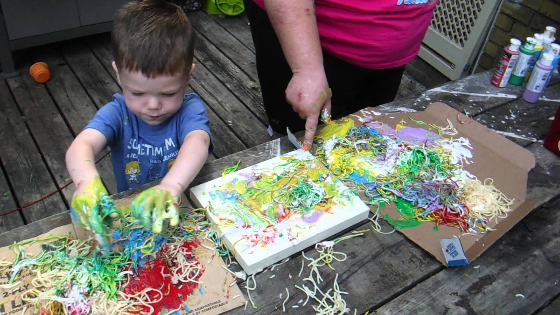This is Ryder painting with spaghetti!!