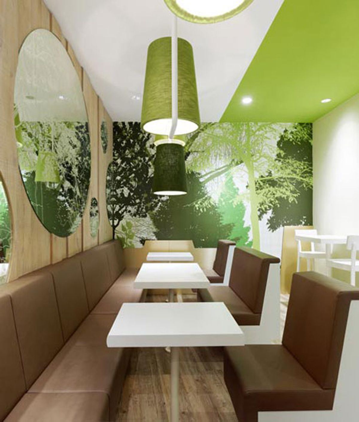 German Design Firm Ippolito Fleitz Group Has Designed The Interiors Of Wienerwald A Fast Food Chicken Restaurant In Munich Germany By Incorporating Tree