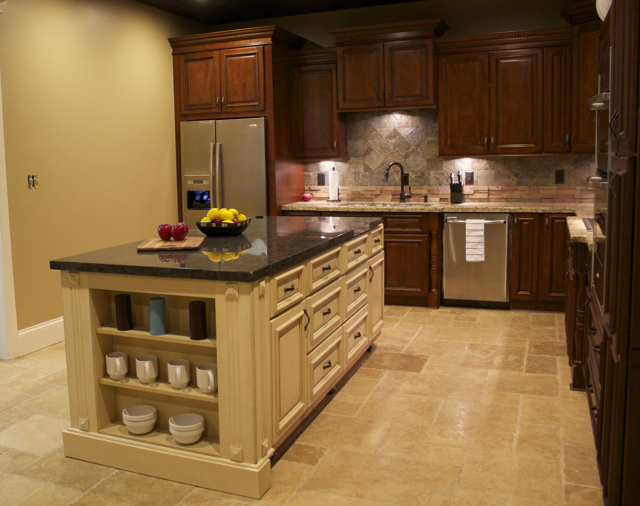 Mixing cabinet colors for contrast. Love the use of trims ...