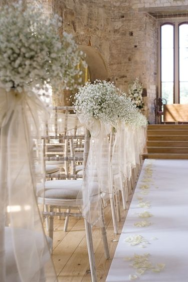 My venue love the gypsophila down the isle and the rose petals babys breath tied to the aisle chairs junglespirit Choice Image