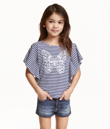 Dark blue/Striped. Poncho top in soft jersey with an embroidered butterfly on the front, cap sleeves and a rounded hem.
