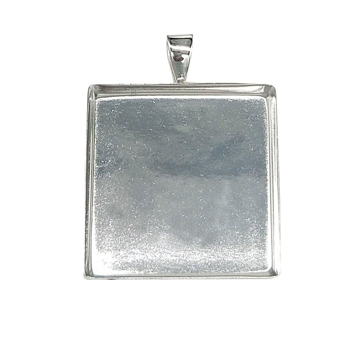 a pretty silver backing pendant 25mm cabochon