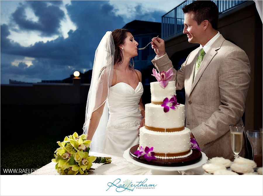 Lovely couple sharing their first bite of wedding cake!
