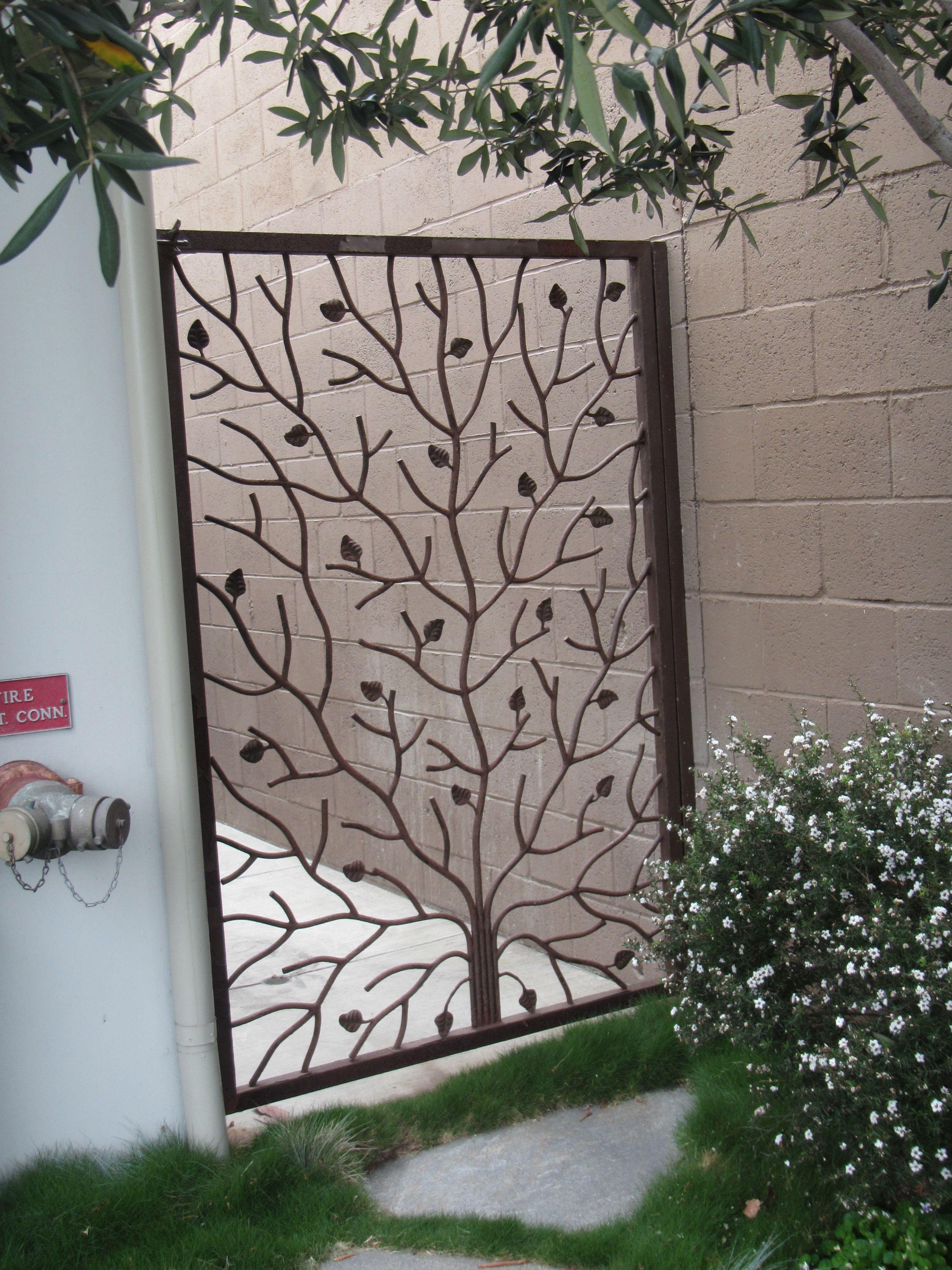 Custom wrought iron gate shut the front door and