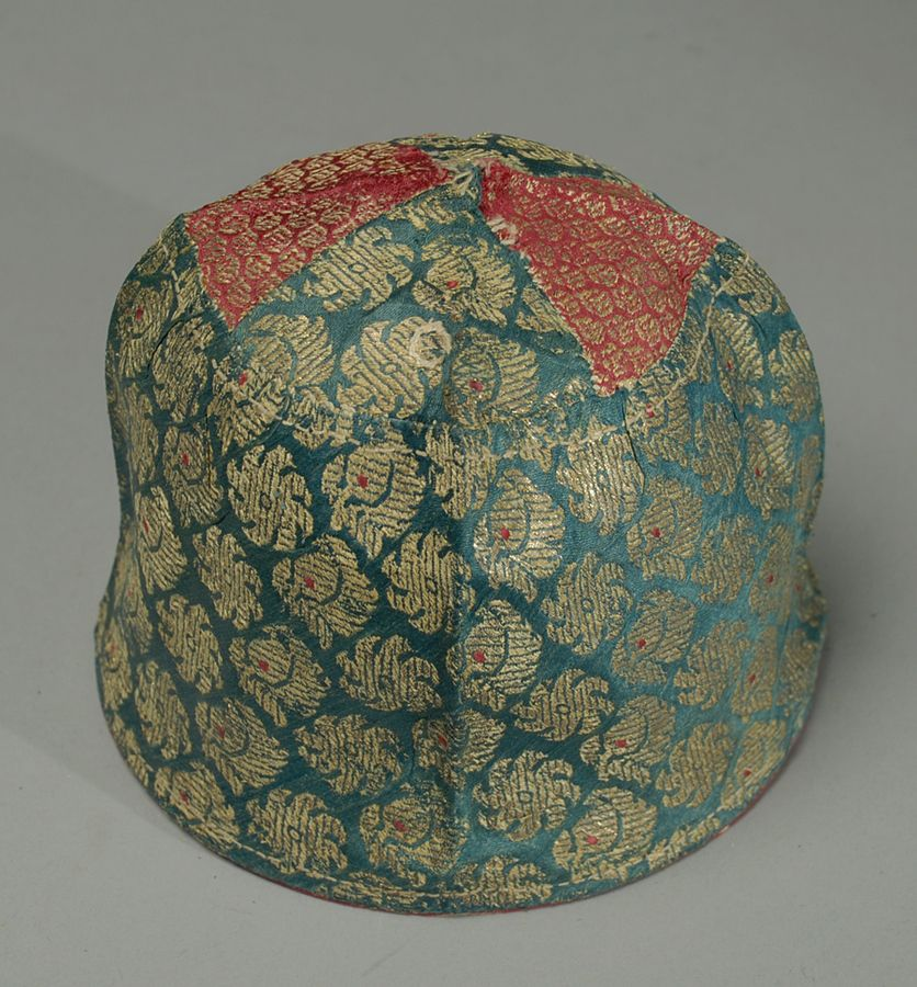 A beautiful 19th century Central Asian hand spun silk wedding hat with fine gold threaded foliate brocades - circa 1860.