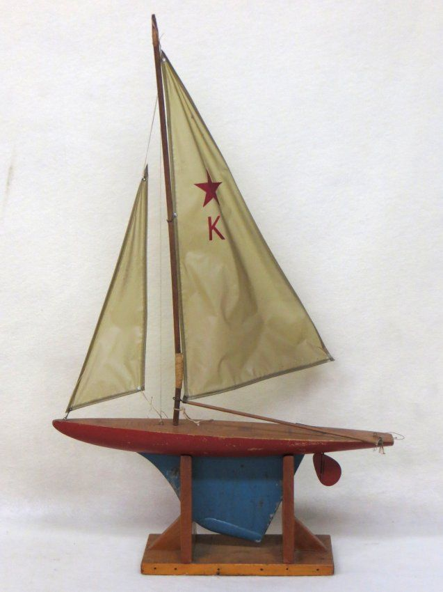 Keystone wooden pond boat with iron keel, old repair to mast