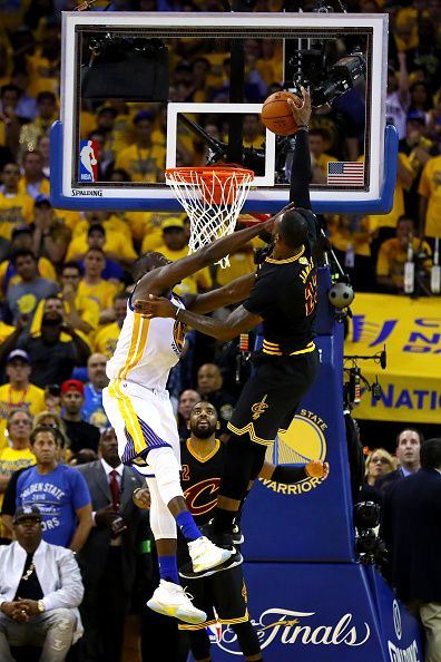 LeBron James of the Cleveland Cavaliers is fouled by Draymond Green of the Golden  State Warriors in Game 7 of the 2016 NBA Finals at ORACLE Arena on. 992097bef