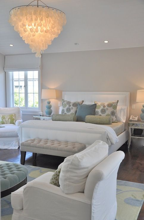 Soft Gray Walls Paint Color White Tufted Bed With Nailhead Trim Velvet Storage Bench Green Blue Rug Slip Covered Chairs