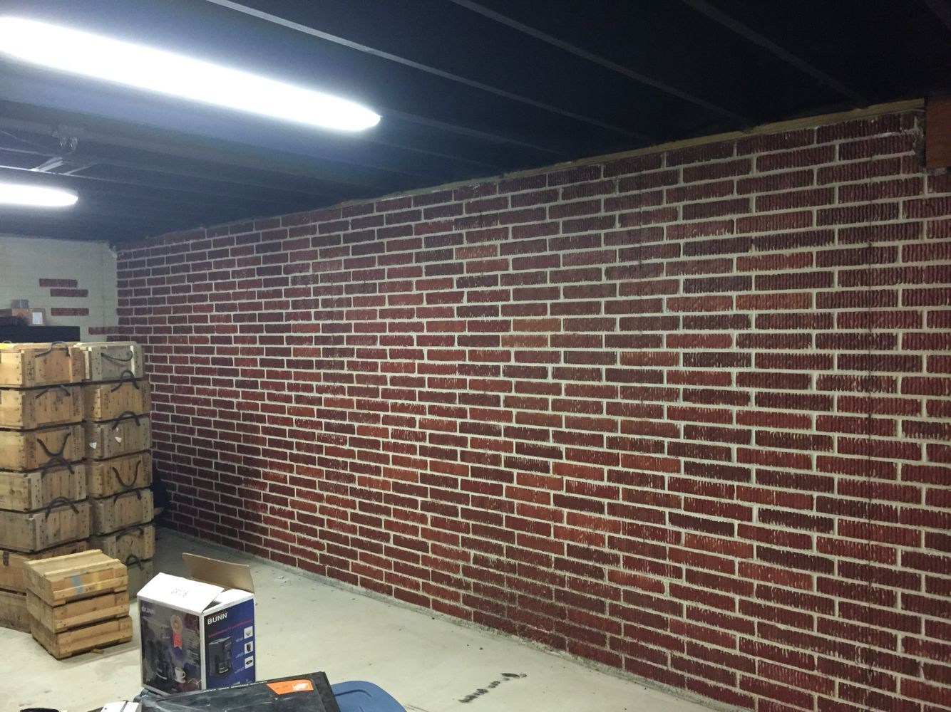 painted brick form poured concrete basement walls with