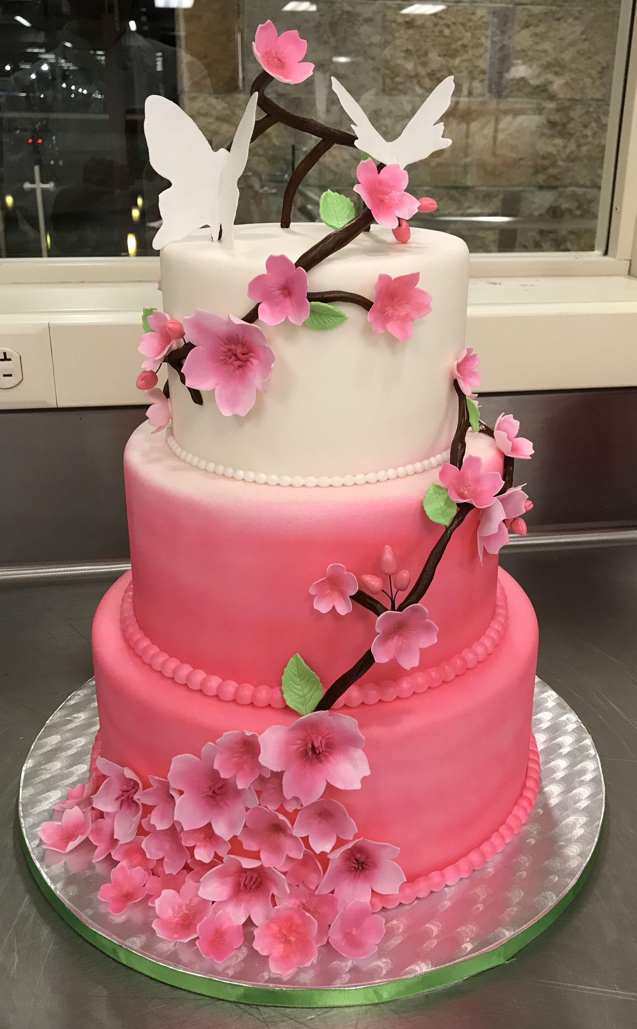 Wedding cake with cherry blossoms and butterfly toppers ...