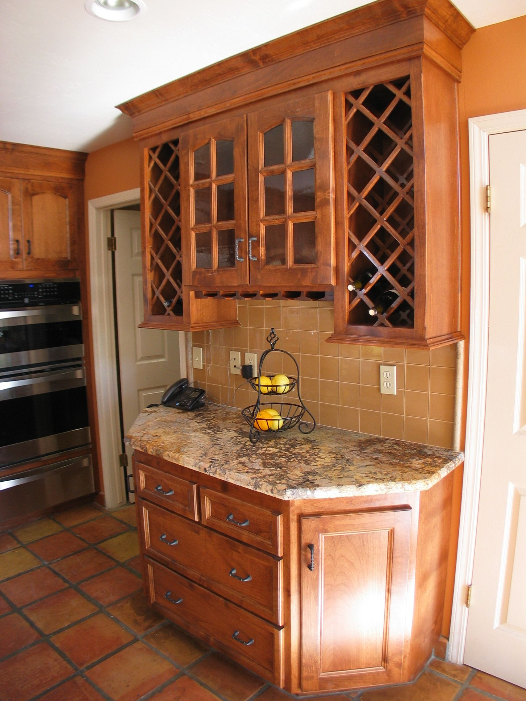 Custom designed kitchen with wood cabinets with wine rack ...