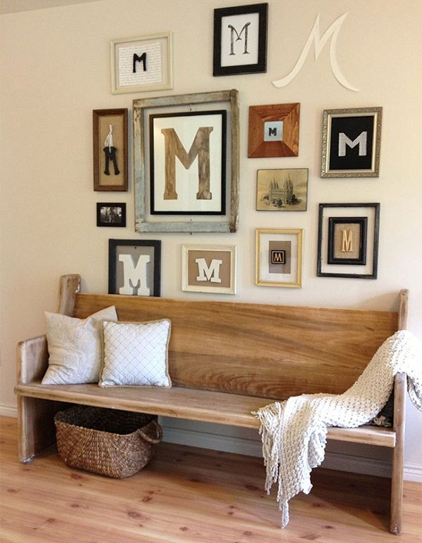 living room decor rustic farmhouse style gallery wall with repetitive framed letter wood pew bench and soft neutral paint color