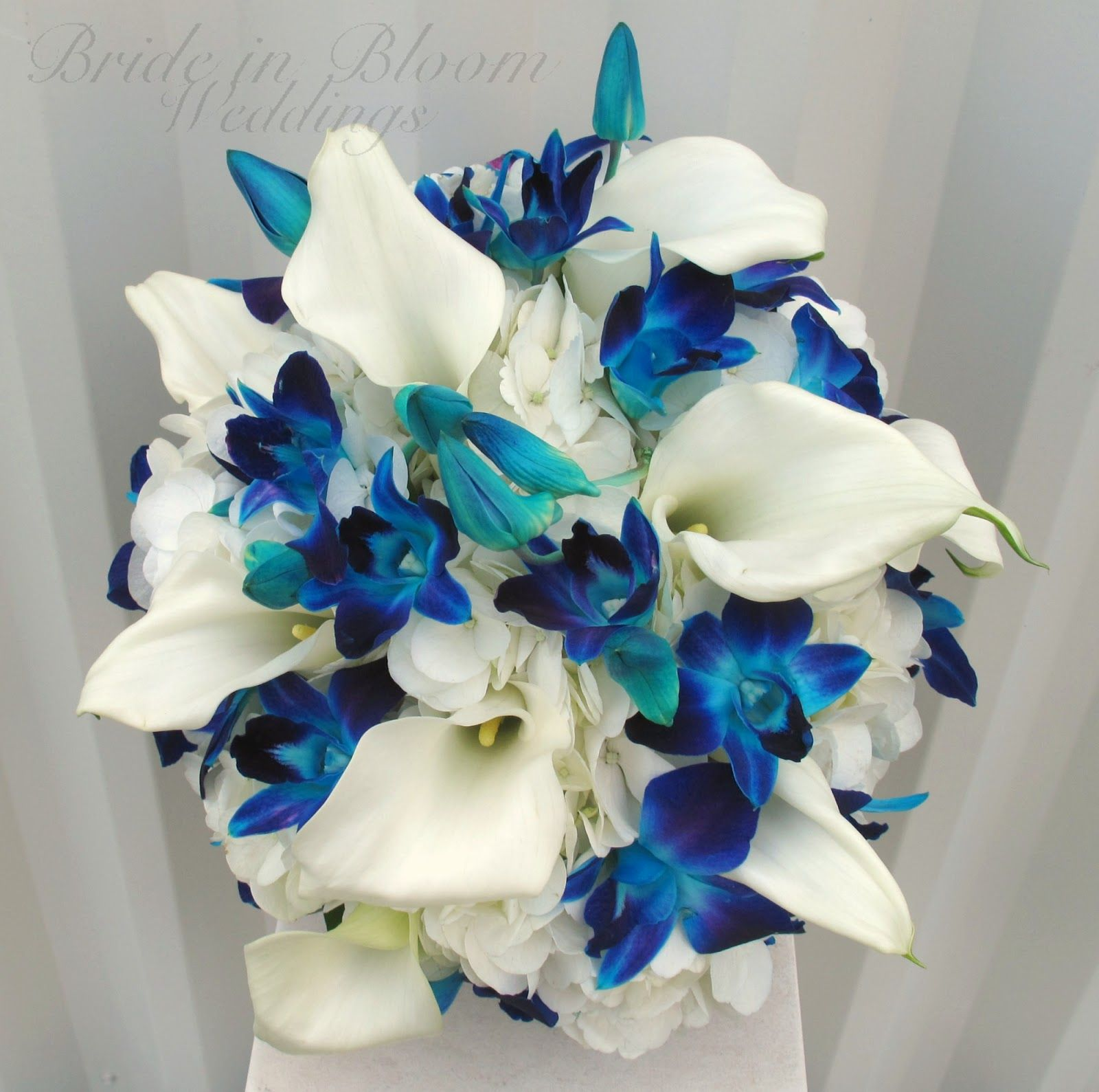 So lovely blue dendrobium orchids with white mini calla lilies