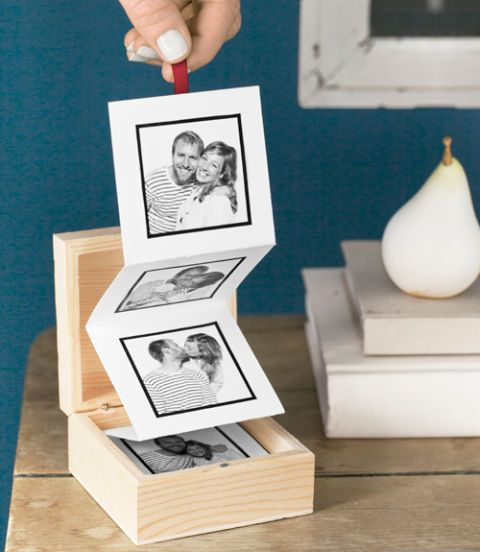 "Transform a series of candid images into a curated collection with the help of a lidded wooden box (woodcrafter.com). Step 1: Cut an 8 1/2""W × 14""L piece of heavy card stock to a width of 2 13/16"". Using a ruler and a pencil, measure and mark the card stock, crosswise, every 2 13/16 inches. Step 2: Fold the card stock at the first mark, creasing it with a bone folder to get a precise line (Fiskars, $8.08; amazon.com). At the next mark, fold and crease the card stock in the opposite direction..."
