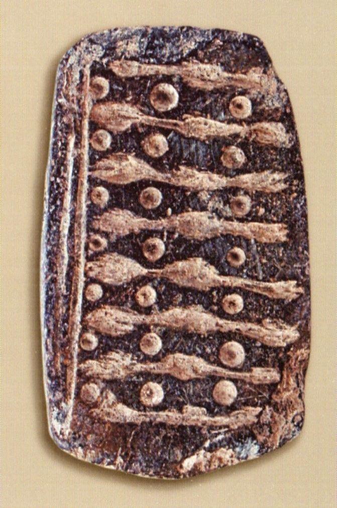 Çatalhöyük, bezekli taş, Konya Arkeoloji Müzesi, Ali Umut Türkcan (Erdinç Bakla archive)