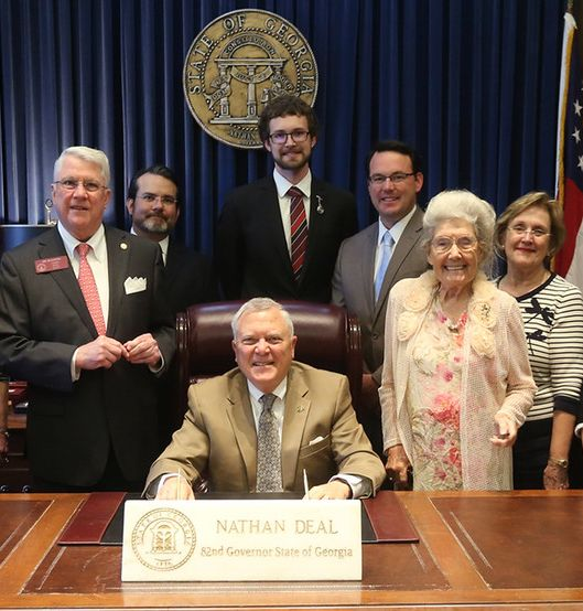 Joe Wilkinson With Governor Nathan Deal At The Bill Signing For SB [Source: Georgia  House Of Representatives Press Release]