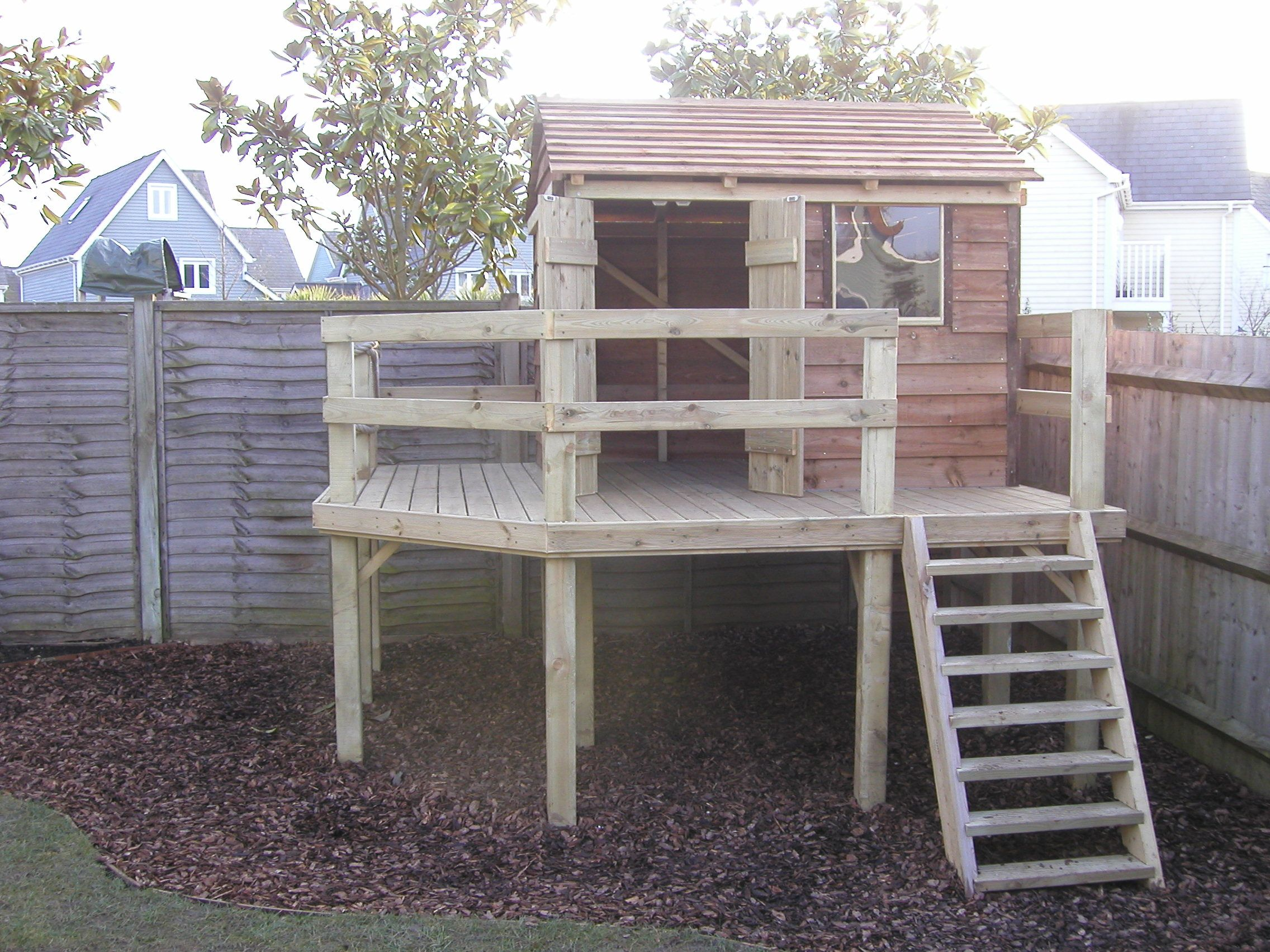 Simple backyard fort make sandbox on bottom slide on one for Simple outdoor playhouse plans
