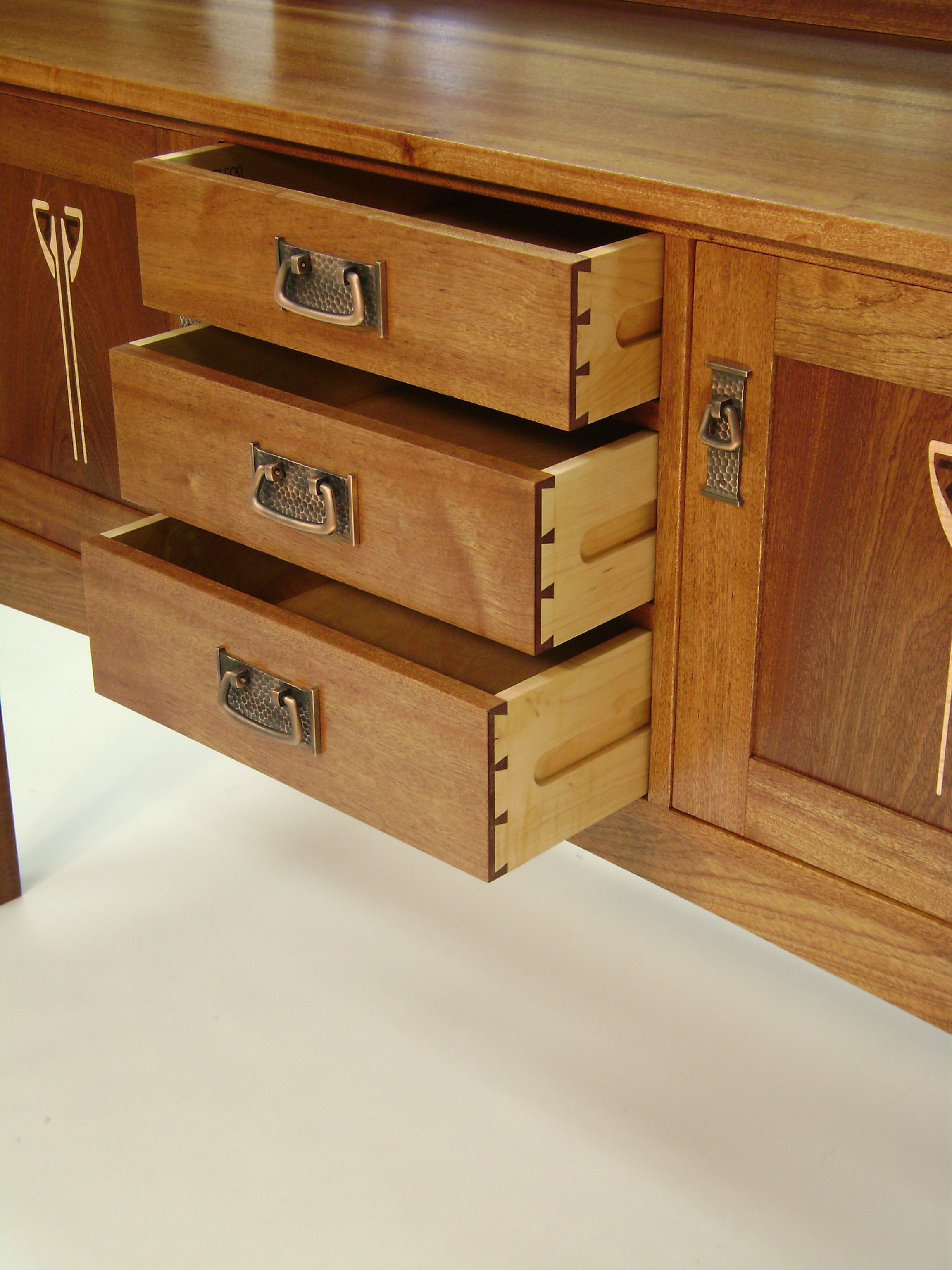 Contrasting mahogany and maple make the hand-cut dovetails pop on these drawers.