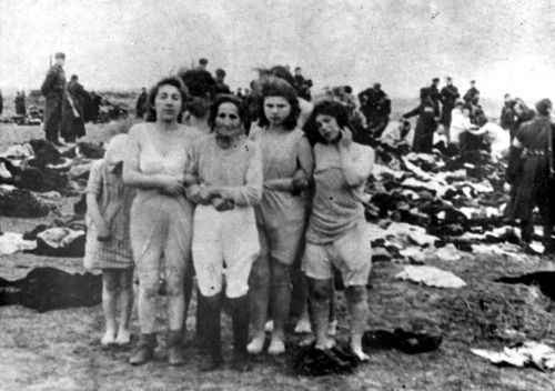 Jewish women and girls await execution at a mass grave in Skede, Latvia. Made to strip down to underclothes as they waited, the women were told to approach the lip of the grave in groups of ten. They were there forced to strip naked, before being shot. Many did not die from the gunshot, but bled to death, or were smothered by the weight of bodies that fell on top of them. In groups of ten, 2,800 human beings were killed between December 15 and 17, 1941. Follow link for their names.