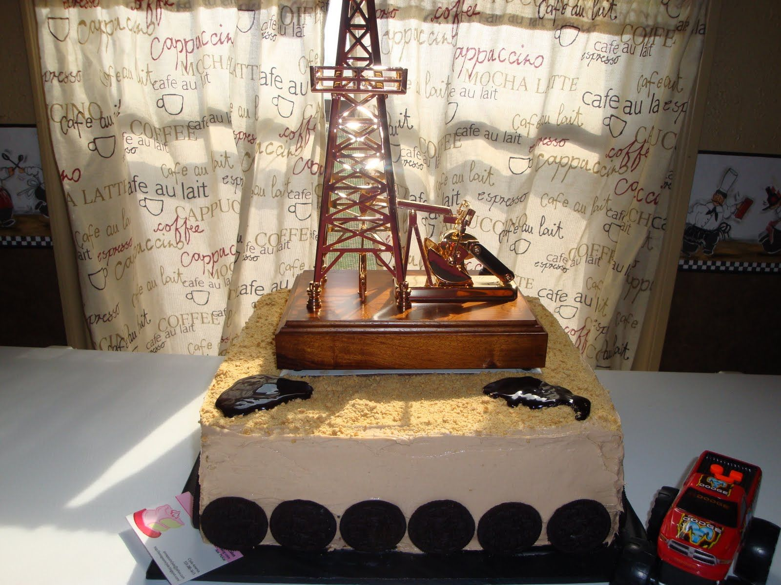 Fondant Oil Pump Jack And Oil Derrick On A Chocolate Cake