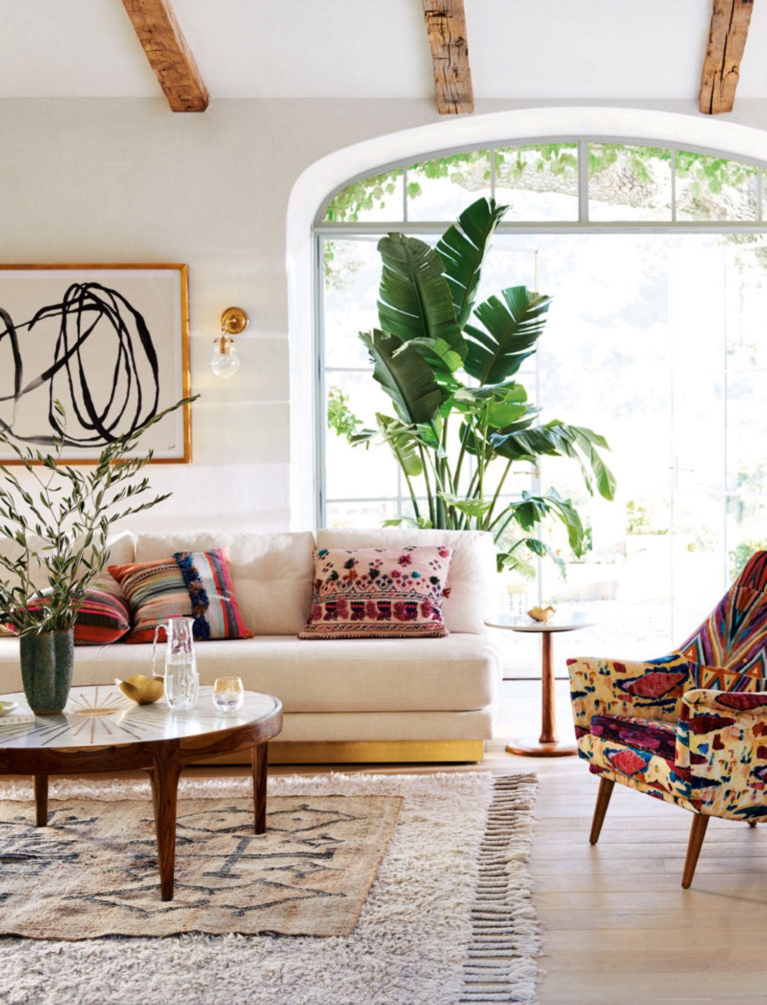from Rooms that Nail the Layered Rug Look