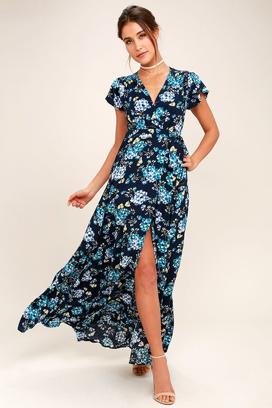 5bd5ab5377 ... Navy Blue Floral Print Wrap Maxi Dress! Blue, teal, white, and green  floral print woven rayon shapes a surplice bodice with fluttering short  sleeves.