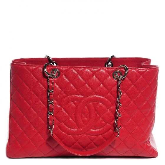63f622b67aa4 This is an authentic CHANEL Caviar XL Grand Shopping Tote GST in Red. This stunning  tote is beautifully crafted of luxurious diamond-quilted caviar leather.