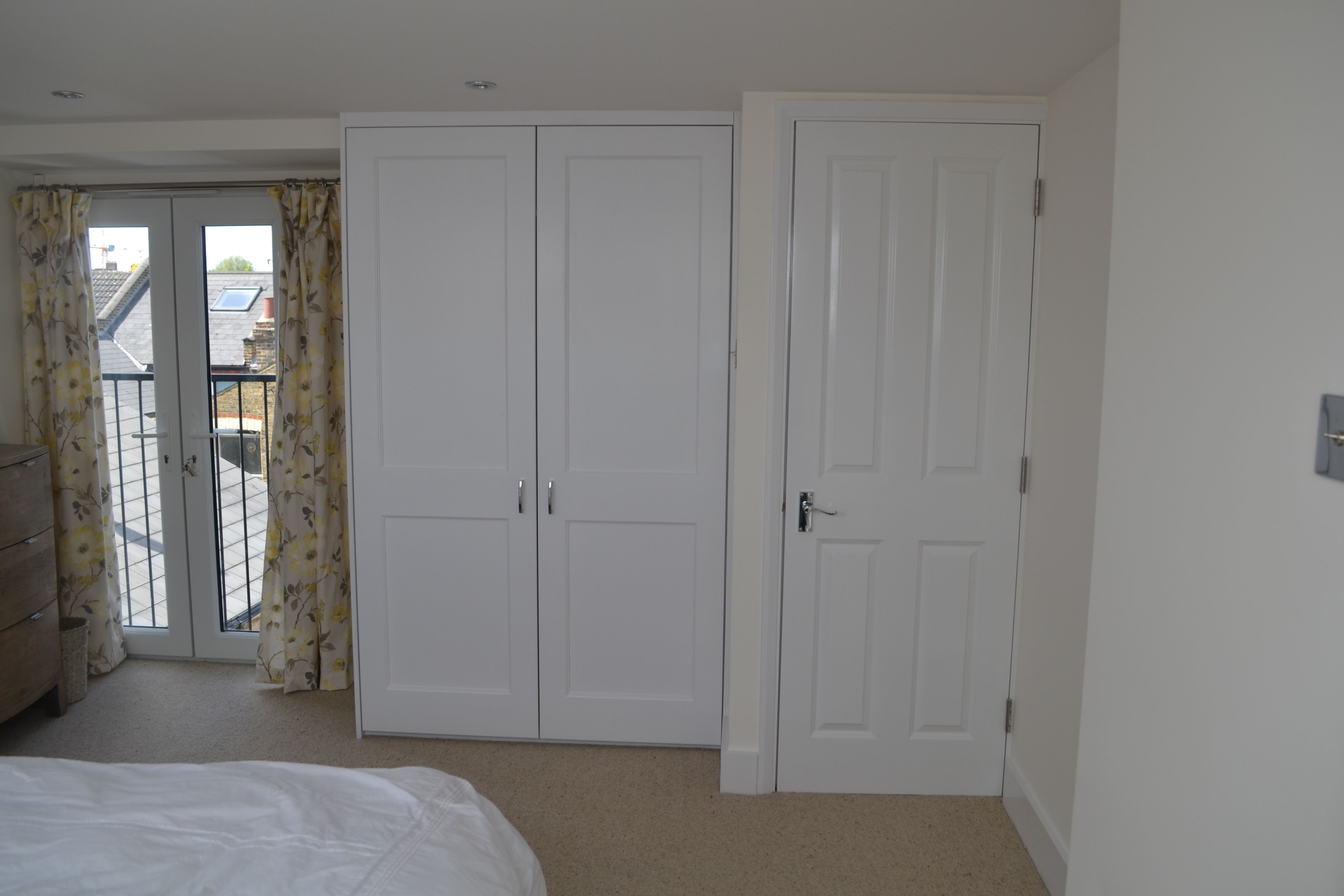 A full width L shaped rear mansard conversion into 2 bedrooms and 1 en-suite