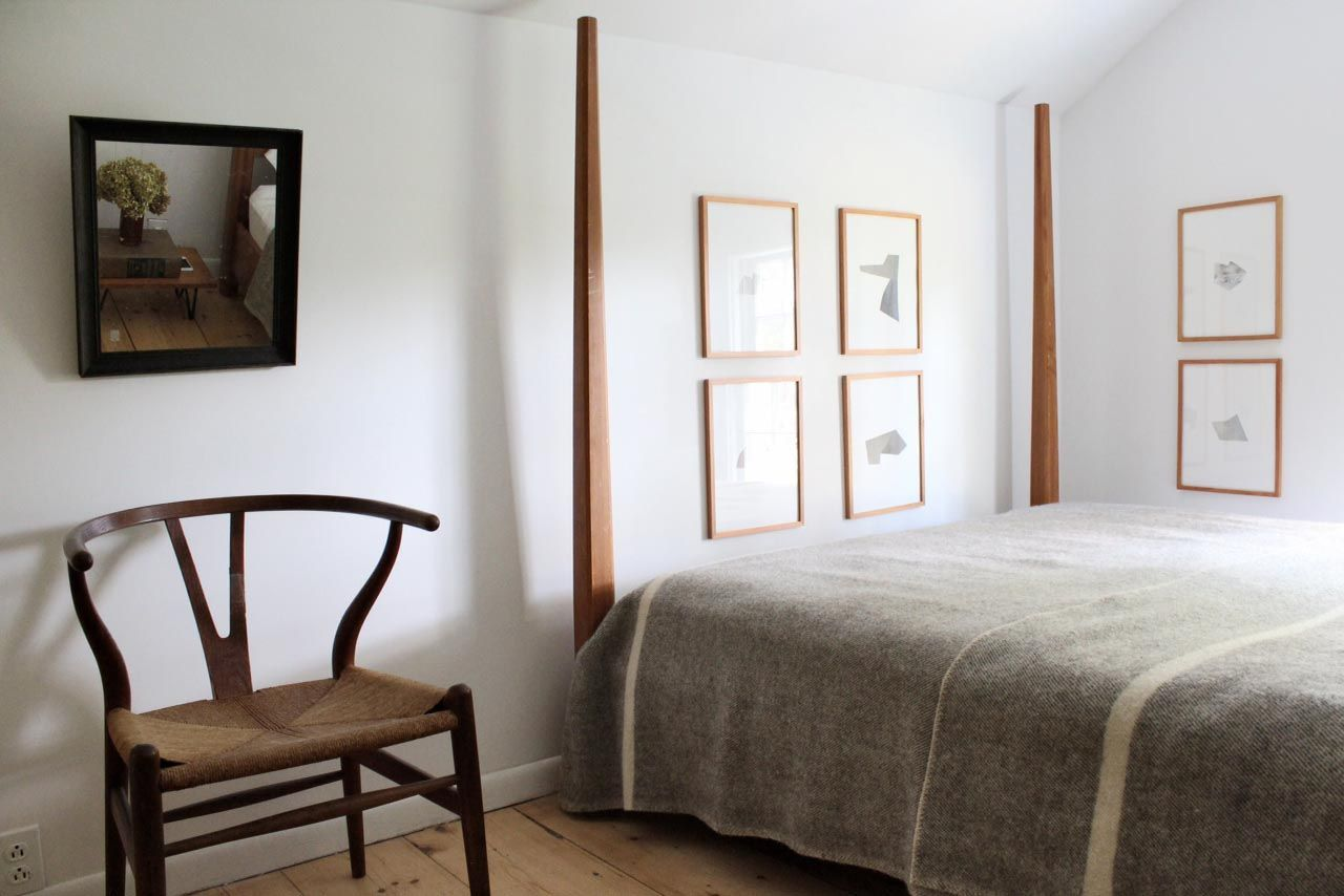 Humble cottage style decor in a bedroom with poster bed. (Click through for full house tour.)