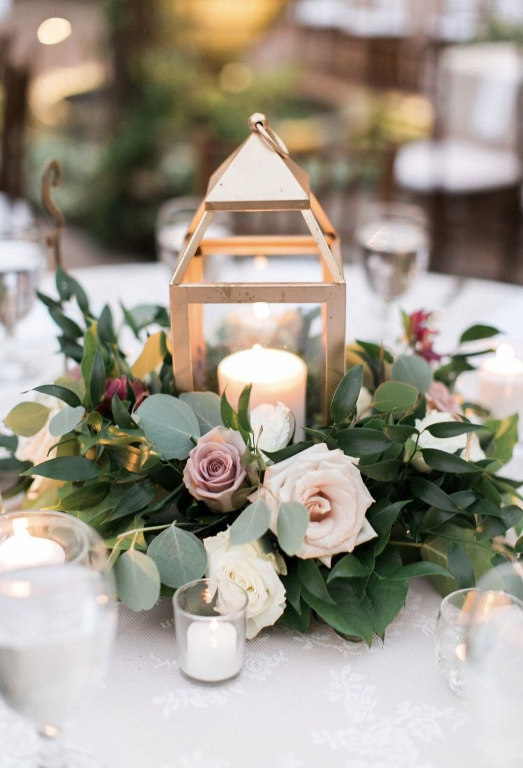 Gold Lantern centerpiece with ring of flowers and greenery Mauve