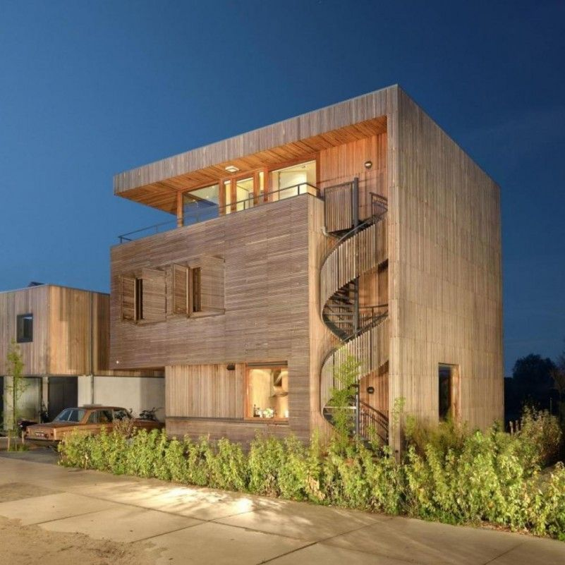 The House Facade With Outdoor Spiral Staircase Wooden
