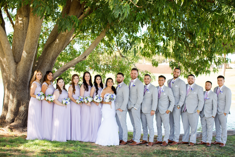 Bridesmaids In Long Lavender Dresses And Groomsmen In Light Grey