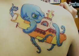 Photo of gelbes U-Boot und Tintenfisch, #Octopus #octopustattooarmsleeve #Submarine #Yellow
