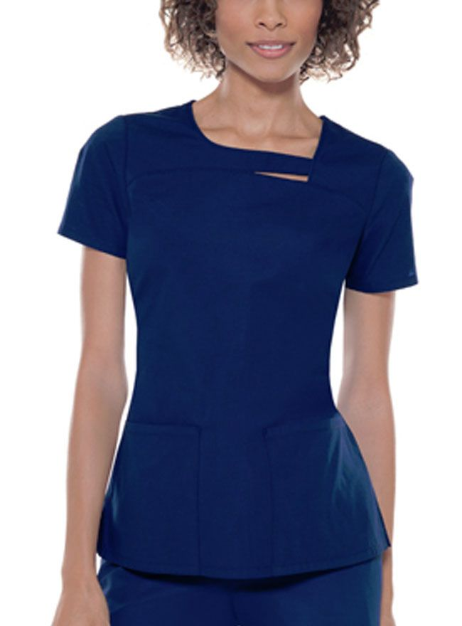 Style Code: CH-26871 This stylish top features a rounded asymmetrical neckline with piping detail, a peek-a-boo, and front patch pockets. Also features back elastic and side vents to add shape.