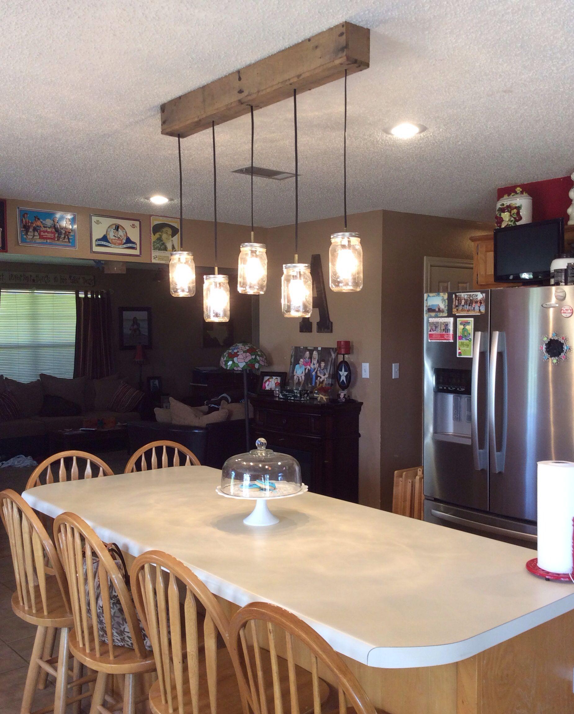 My DIY kitchen mason jar light ( hubby made)  hanging over my bar.