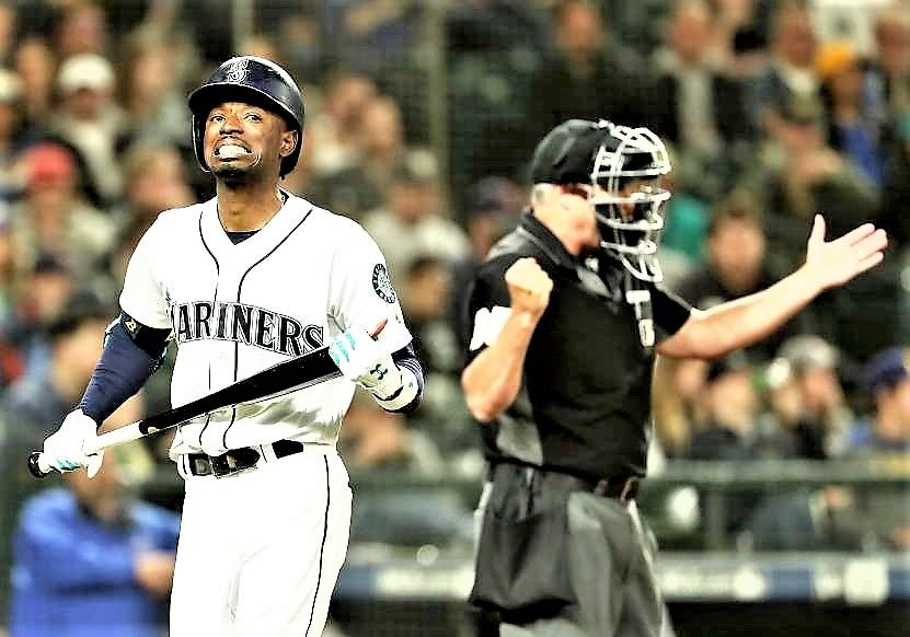 Strike out Dee Gordon of the Mariners, reacts after