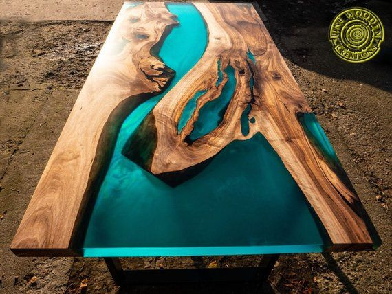 Photo of Turquoise resin dining table with glowing inlay