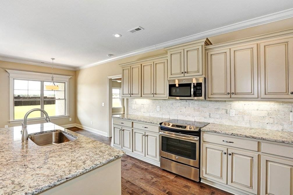 Best Our Cabinets Granite Is Dallas White Backsplash Is New 400 x 300