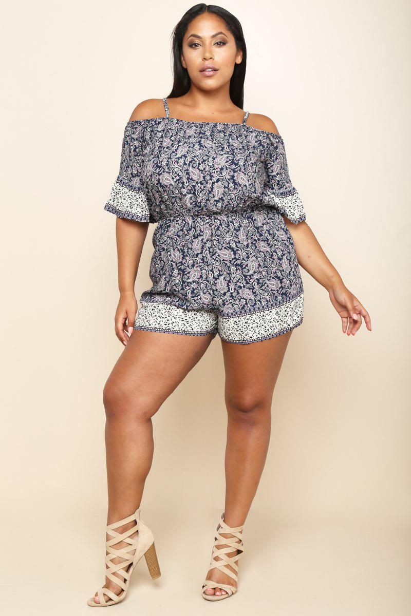 A plus size romper with an off-shoulder neckline and a cinched waist. Features half sleeves and contrast blocks. Paisley print all over.