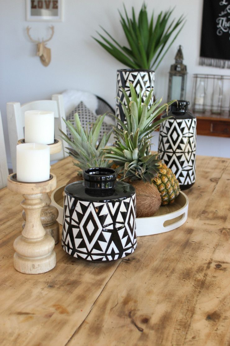 Dining Table Vignette Pineapples Coconuts Candles Vases Aztec