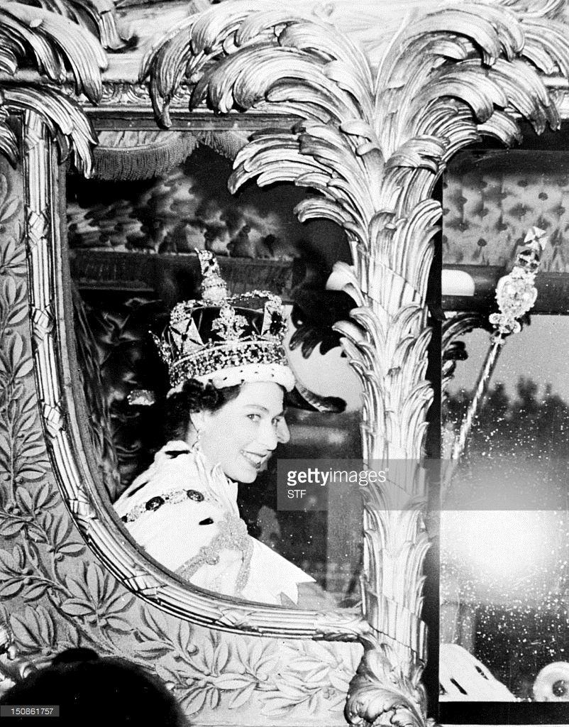 Queen Elizabeth II is seen through the window of the royal