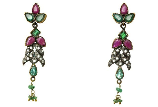 Mughal Ruby & Emerald Earrings Formal gemstone earrings in a classic Indian Mughal design. The stones are set in open backs so light transmits through them with intense sparkle. Pear-cut emeralds and rubies make up the bulk of the design.